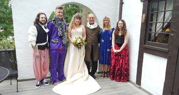 A wedding party of six dressed in costumes.