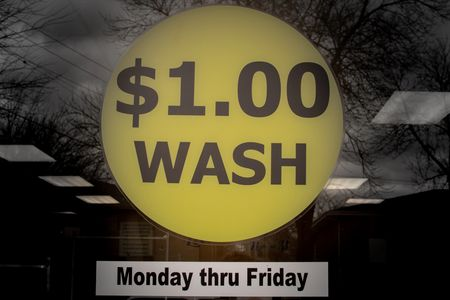$1.00 wash special window display at The Laundry Room 8418 W Morgan Ave Milwaukee