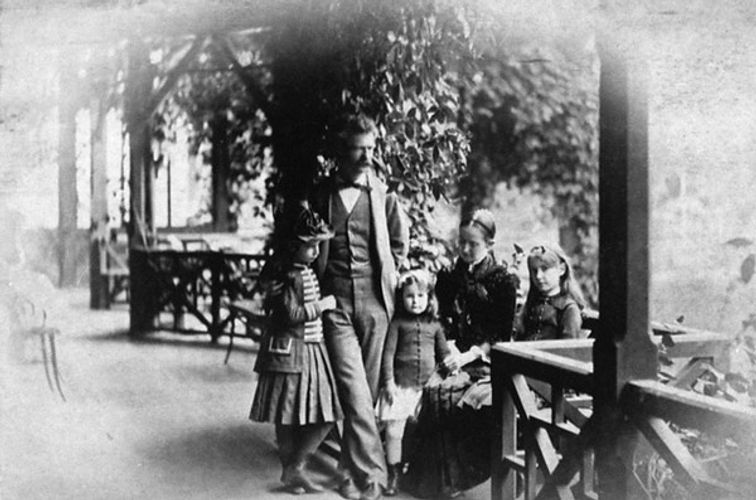 Mark Twain with daughter, Clara, Jean, Susy, and wife Livy on porch of Hartford, Connecticut home