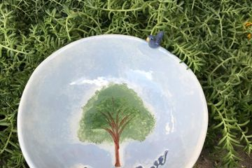 "A useful 5"" round bowl reminding you to grow love daily. Deeply embossed tree and wording. Outside e"