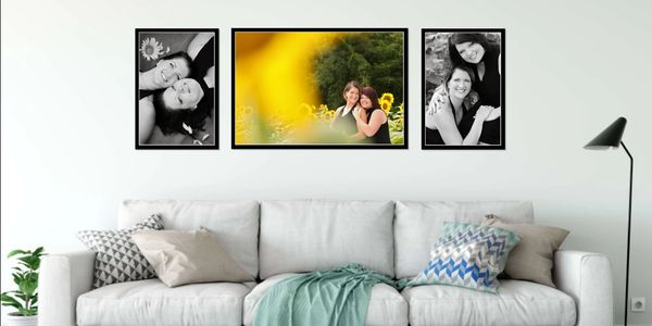 Three large portraits of mother-daughter framed and hanging on wall above sofa