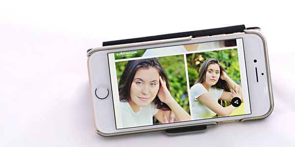 senior pictures of girl on screen of an iphone