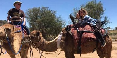 two participants enjoying the Hands on Camels Weekend at the Oasis Camel Dairy