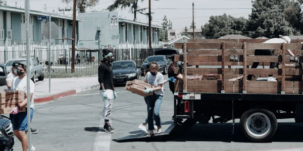 Charity organization volunteers unload food to be distributed to people in need.