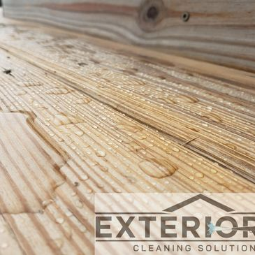 Water proofing and weather proofing of a new wood deck.     Protect the deck from the elements.