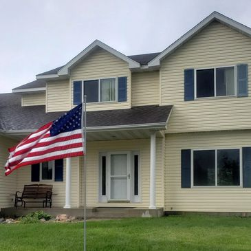 House Soft Wash, Roof Treatment and Roof Cleaning.   Exterior Cleaning Solutions American Flag Program.  Concrete Cleaning. Stewartville, MN