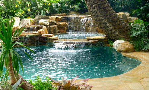 Pool waterfalls in Florida waterfall into swimming pool waterfall company