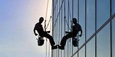 person hang off with rope for glass cleaning