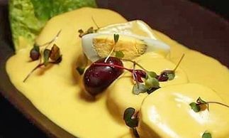 Potato with peruvian yellow pepper and white fresh cold cheese creamy sauce.
