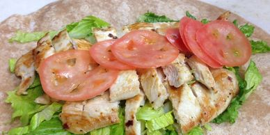 Grilled chicken wrap with lettuce, tomato, and mayo.