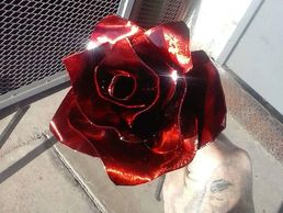 Hand Sculpted and Cut Red Steel Rose