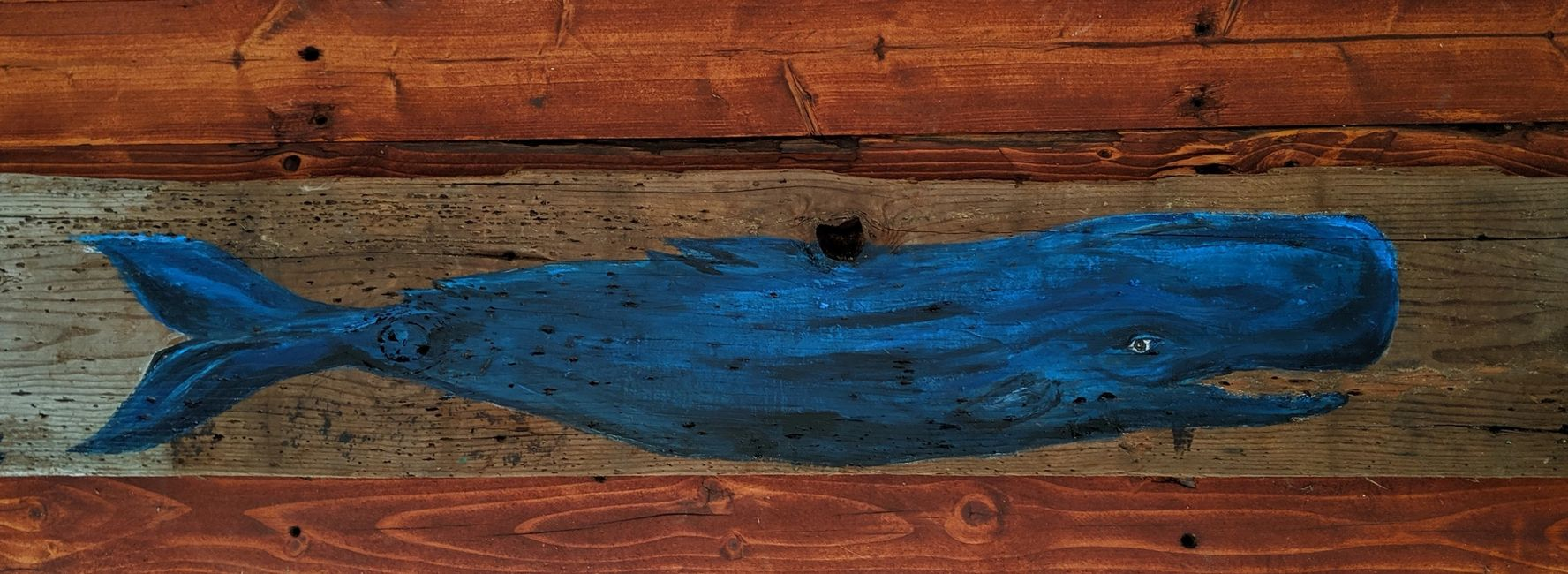 Acrylic painting of sperm whale on reclaimed barnwood