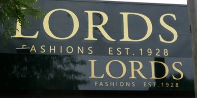 Shopfront Fascia signage: hand painted and computer cut vinyl for Lords Fashions, Hare St, Echuca