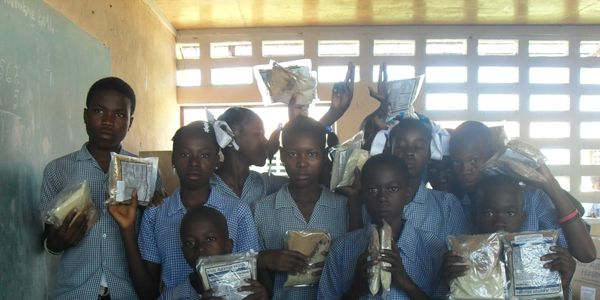 Packets of food being distributed to orphanage schools in the Artibonite Valley in Haiti.
