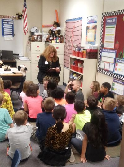 Reading to an elementary school class for Nevada Reading Week
