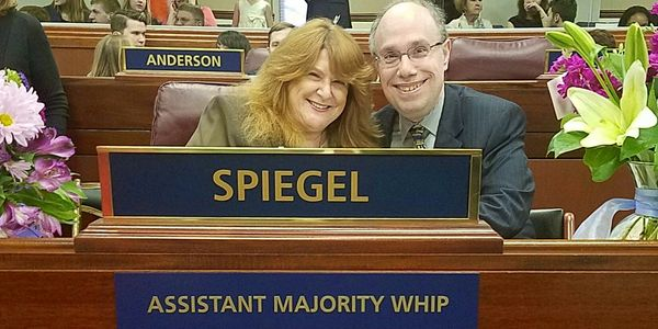 Ellen was proud to serve as Assistant Majority Whip and is pictured here with Bill on opening day.