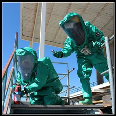 Two HazMat technicians in Level  A suits