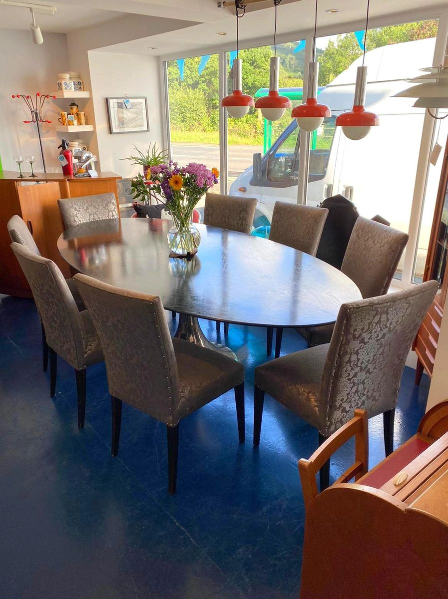 Picture of: Julian Chichester Ebonised Oak Oval Dakota Dining Table With Hand Beaten Nickel Base With Eight Silver