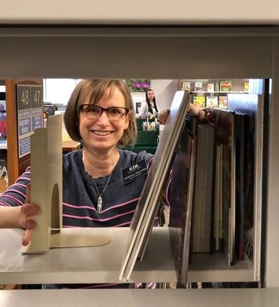 Vanessa Walstra, Cascade Branch Library manager, recently installed the first of 1,200 new bookends.