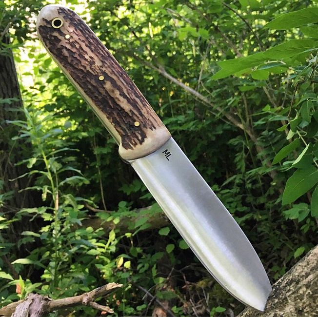 ML Knives Kephart Knife in antiqued Elk stag. Shown with Clean blade & Brass Hardware.