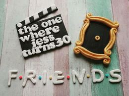 Friends peephole and clapperboard cake decoration