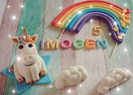 Unicorn and rainbow with clouds cake decoration