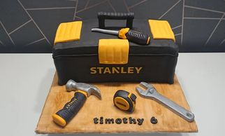Tool box cake with hammer, tape measure and wrench