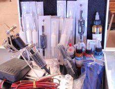 Tattoo machines, power supplies, inks and medical products in kits and individual items
