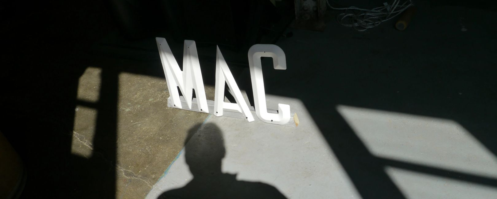 image of human shadow and the MAC gallery logo.
