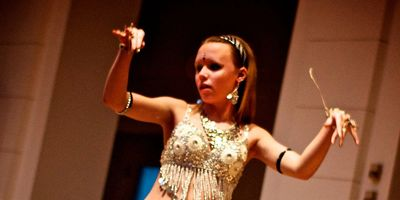 Julie of Zuut performs a belly dance solo at the Albright-Knox Art Gallery in Buffalo NY