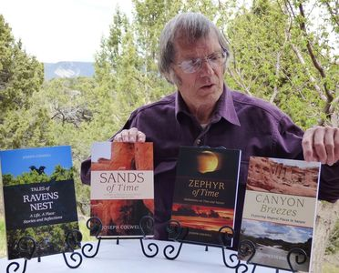 Author Joseph Colwell with his beautiful books of essays and fiction.