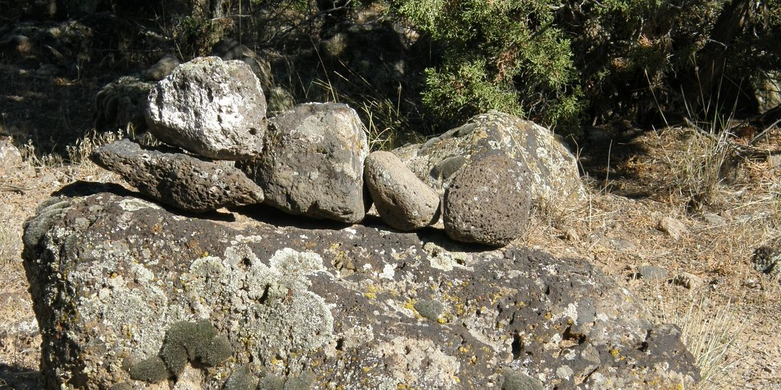 Rock cairns, flagging, and rustic signs guide you along the hiking trails at Colwell Cedars Retreat.