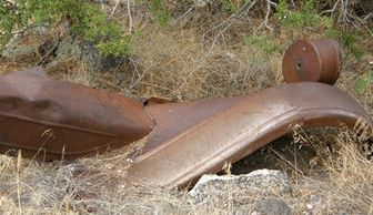 Rusty vehicle parts, old homestead remains at Colwell Cedars Retreat.
