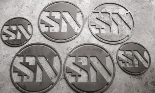 plasma cut signs in fabrication shop