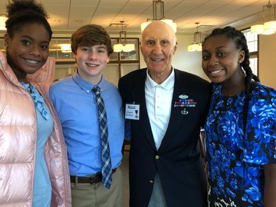 Mr. Michienzi meets three of the Envoys of Honor at a Veterans Ceremony at Carolina Meadows