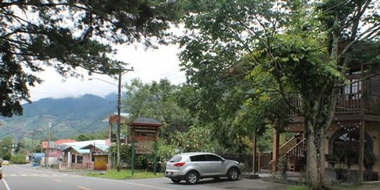 30 sec. walk brings you to QUETZAL LODGE & SPA. (The wooden building on the right of this picture)