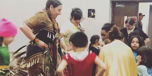 Bdote Learning Center having cultural education through Pow Wow activities with guest dancer.