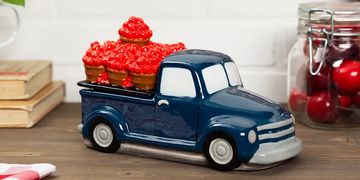 Blue truck with red apples in bushels on wood countertop scentsy warmer interchangeable lids