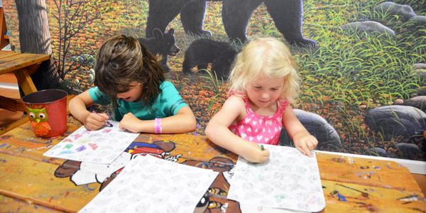 Kids coloring in Bear Club kid's activity area