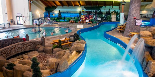 Lazy River and Activity pool with people playing basketball