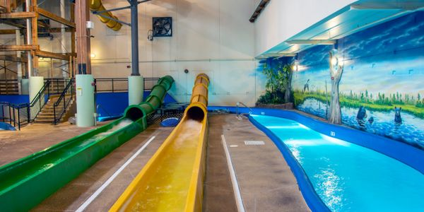 waterslides and lazy river in indoor waterpark