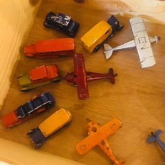 Vintage metal toy Tootsie cars and airplanes.