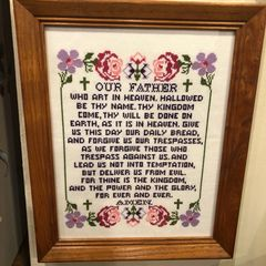 Cross-stitch prayer wall art.