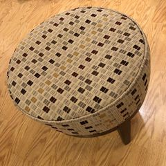 Upholstered stool.