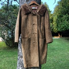 Vintage deerskin coat with fur collar.