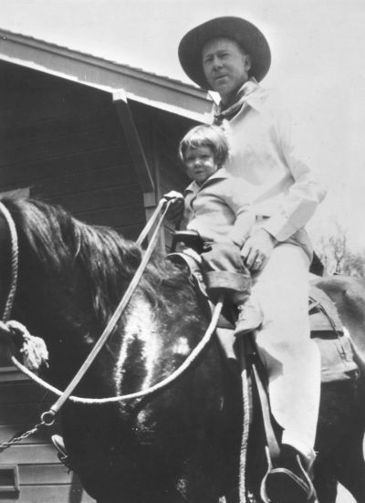 Tom Raley riding a horse with little Joyce back in the 1930's. Prior to the Raley's Supermarkets.