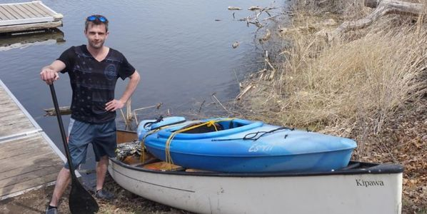 Local Hespeler hero Tayler Seaton safely retrieves submerged canoe using tiny kayak