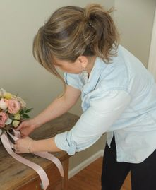 Finishing Touches on Wedding Bouquet designed by Poppies and Twine Event and wedding Florist, Maine