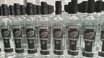 Smooch Vodka 750ml bottles on production line