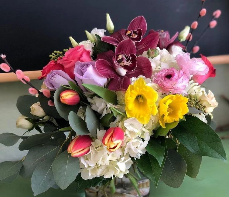 Mother's Day Flowers designed with Tulips, Hydrangea, Roses, and Eucalyptus. Flowers delivered.